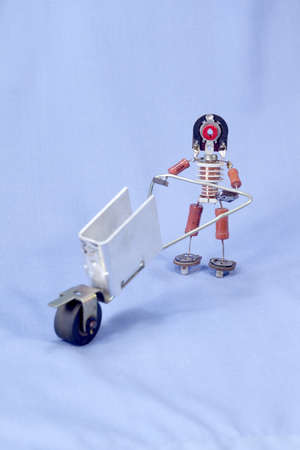 capacitance: puppet man with an empty toy truck Stock Photo