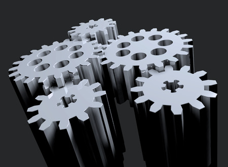 composition of several linked in rotation toothed gears Stock Photo