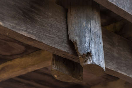 exactness: close up of joint old wood poles at wooden house
