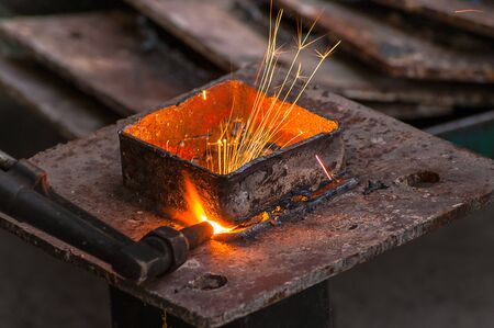 Metal cutting, steel cutting with acetylene torch, industrial worker on working area Stock Photo