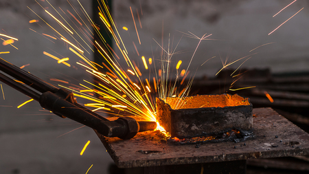 metal cutting: Metal cutting, steel cutting with acetylene torch, industrial worker on working area Stock Photo
