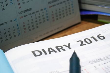 writ: Daily planner year 2016 book on the wooden table