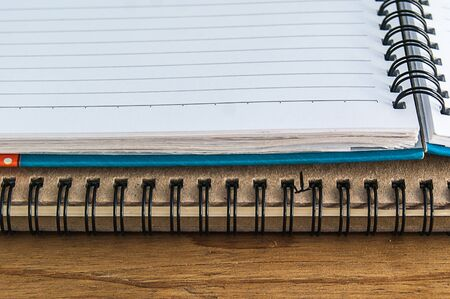writ: closeup of diary book with blank page on wood tabel Stock Photo