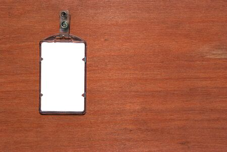 cardholder: Blank ID card  badge with blue belt on wooden wall