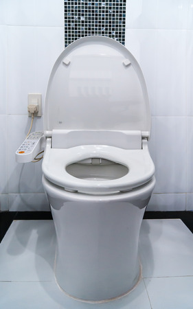 empty the bowel: Hygienic and high technology of the toilet bowl, automatic flush Stock Photo