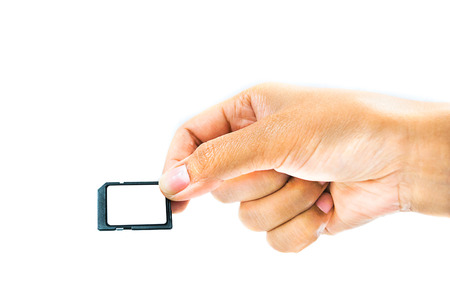 Isolated Hand with memory card. Memory data for digital technology.