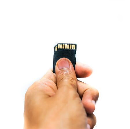 sd: Hand with SD CARD. Memory data for digital technology isolated.