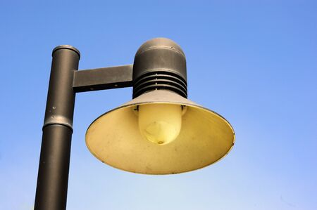 Streetlight on sunny day.  photo