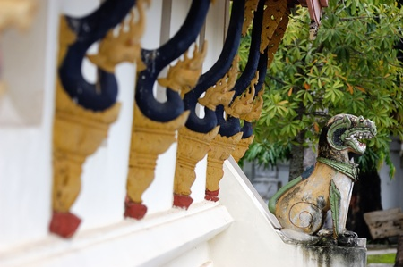 banian: Lions stone  in front of Lao temple style in Luang Prabang, Laos
