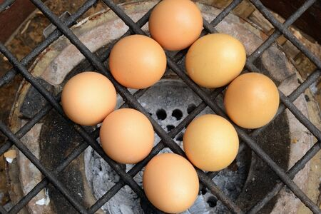 gridiron: Grilled chicken eggs over stove gridiron and low heat.  Stock Photo