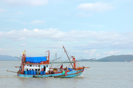 The fishing boats go to open sea on sunnyday at Rayong,Thailand  photo