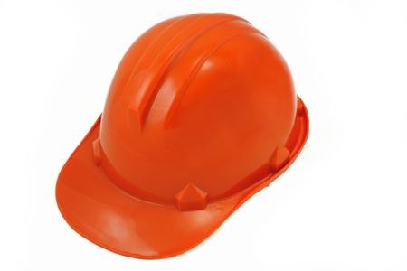 Plastic orange safety helmet over white background. photo