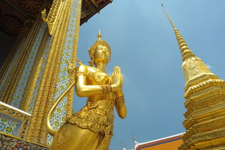 Mythical female bird with a human headache at Emerald Buddha temple in Bangkok,Thailand. photo