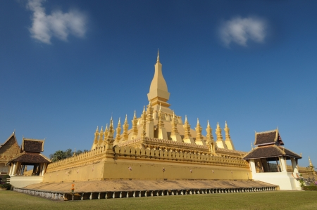 Golden temple architecture in vientienne Pha That Luang and its place in Vientiane, Laos  photo