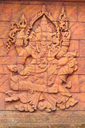 A stone carved sculpturee statue of an Indian god  photo