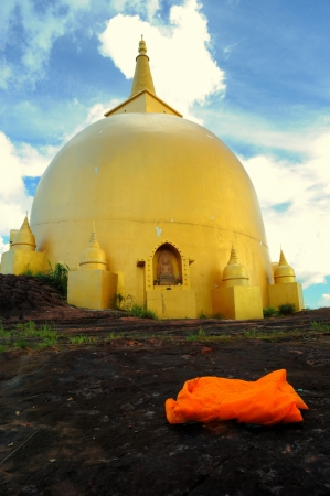 venerate: The golden pagoda in sunnyday on Phu Lanka, Thailand