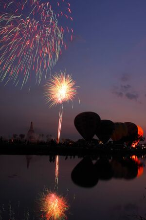 Fireworks show and balloons in the night at Thailand  International Balloon Festival  photo