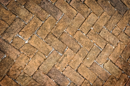 Old dirty brick stone floor texture in garden  photo