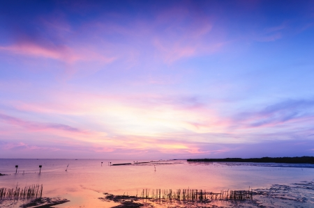 Beautiful twilight silhouette sunset at tropical sea in Thailand  photo