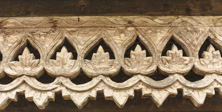 Carved wooden lattice work with Thai style pattern art in Thailand  photo