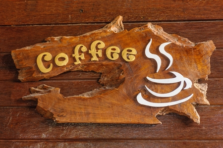 Old retro wooden sign with the text coffee shop  photo