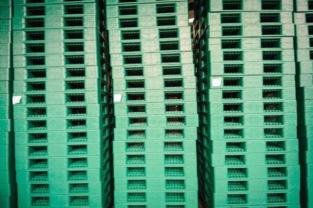 sorted: Green plastic pallets in warehouses, sorted and delivered. Stock Photo