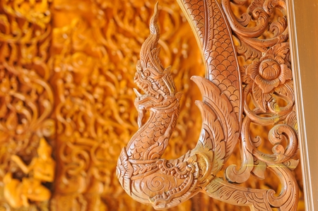 teak wood: Beautiful Naga teak wood carving sculptures Thai temple in Chanthaburi, Thailand.