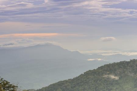 range of motion: Beautiful sunset tropical mountain mist in rainforest, Thailand.