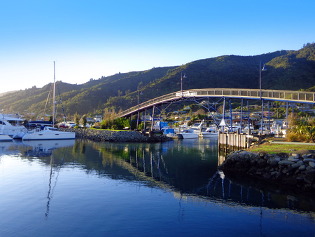 Beautiful Harbor of Picton New Zealand. Turquoise Ocean with Yachts and Boats Фото со стока
