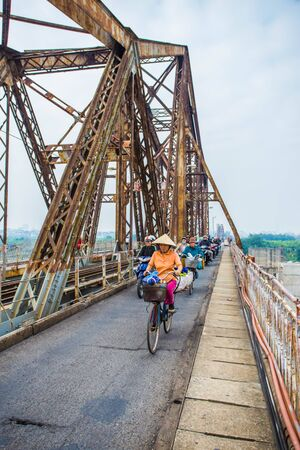 mopeds: HANOI, VIETNAM, Decenber 3, 2016: Long Bien railway bridge, at the center Hanoi, Vietnam, used by trains, mopeds, bicycles and pedestrians.