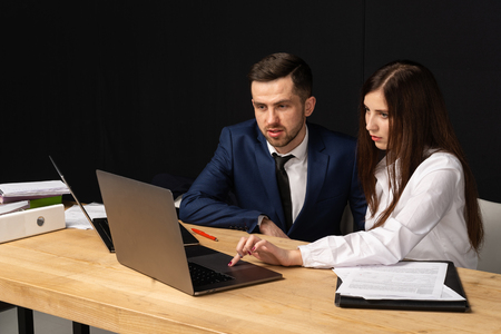 Male and female business partners collaborating on new startup