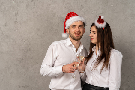 Young business people in santa hat with champagne Banco de Imagens