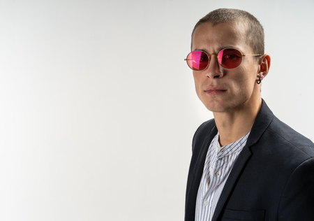 Close up portrait of young and handsome business man in sunglasses Stock Photo