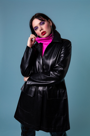 Portrait of styled professional model in leather jacket