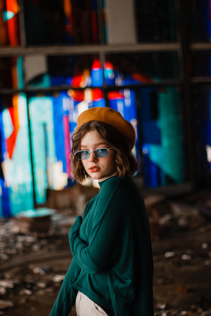 Portrait of curly hipster girl in blue sunglasses