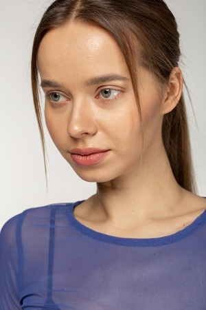 Close up portrait of beautiful woman with big blue eyes healthy skin and red lips