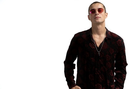 Half length portrait of young confident and succesful male enterpreneur in black shirt and red sunglasses, with short haircut, looking at the camera, copyspace for your text