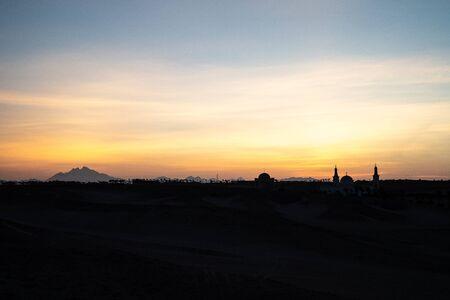 Beautiful amazaing panorama, desert after sunset, colorful sky