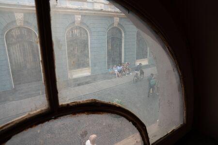 Chernivtsi, Ukraine, 25.08.2019: Photo through the retro wooden window, pedestrian street Publikacyjne