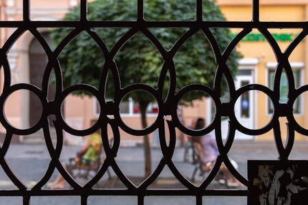 Chernivtsi, Ukraine, 25.08.2019: Photo through the forged gates, pedestrian street of the old city