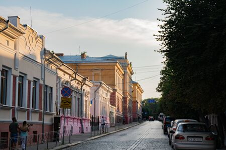Chernivtsi, Ukraine, 25.08.2019: Old city paved street with old buildings, summer day