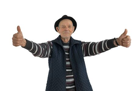 Confident, calmy senior european man with double thumbs up gesture, dressed in casual clothes and black hat, looking at the camera isolated over white background
