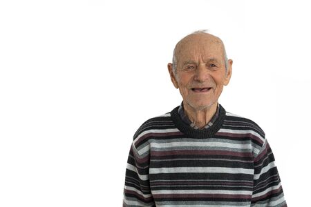 Close up portrait of an old male, man in casual clothes, senior smiles and shows his mouth without teeth, isolated over white background, copyspace for your text Stock Photo