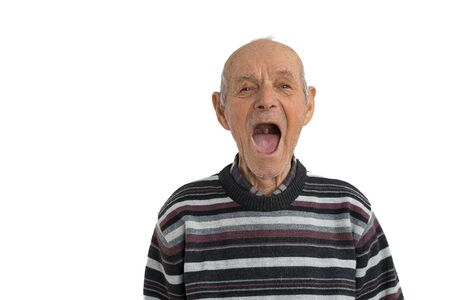 Handsome old man in casual clothes showes his mouth without teeth isolated over white background, need a dentist, copyspace