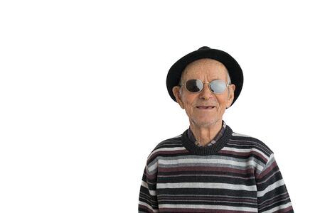 Happy smiling man in black hat and sunglasses, toothless senior looking at the camera isolated over white background, copyspace Foto de archivo