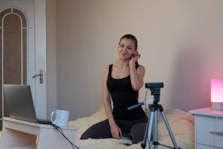 Influencer Young girl blogger talks about to your subscribers. Woman recording video blog tells be in social networks. Bloger talks facial how to organize your blog.