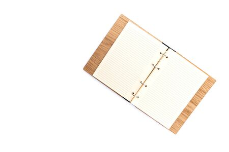 Business concept - Top view of wooden notebook with white open page isolated on background for mockup 写真素材