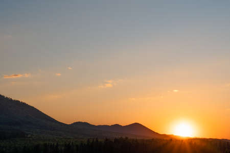 A beautiful scenery of a mountain range with the sunset in the background Standard-Bild