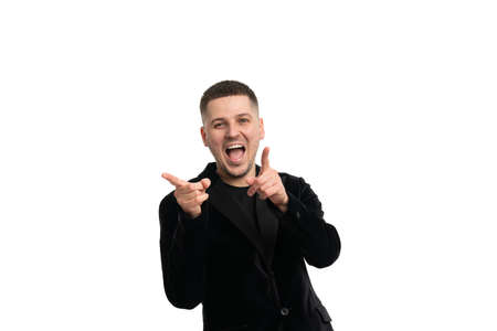Young caucasian business man against a white background isolated excited pointing with forefingers