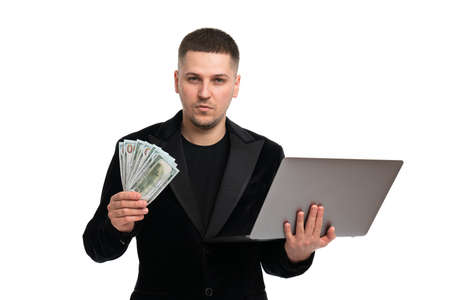 Businessman made huge profits, showing a lot of money. A man in a suit holds a pack of new banktons of USA